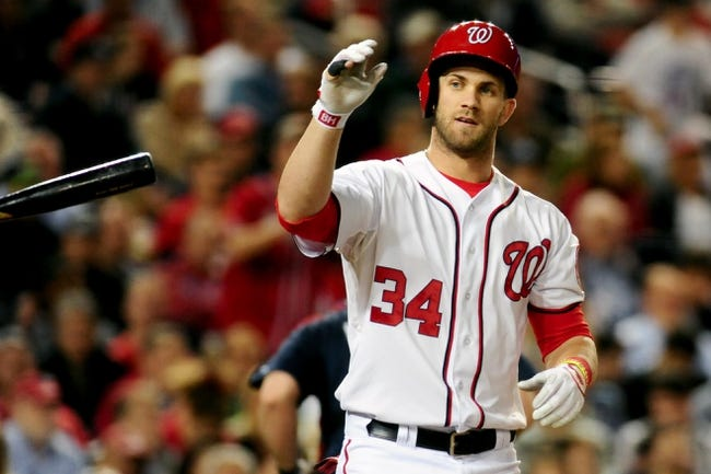 Sep 18, 2013; Washington, DC, USA; Washington Nationals outfielder Bryce Harper (34) reacts after striking out to end the third inning against the Atlanta Braves at Nationals Park. Mandatory Credit: Evan Habeeb-USA TODAY Sports
