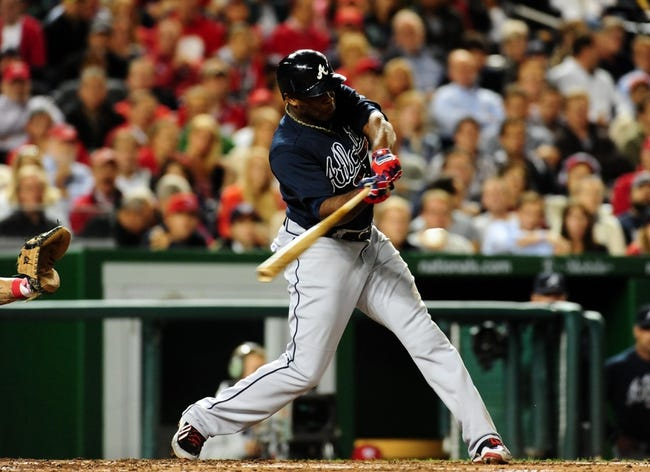 Sep 18, 2013; Washington, DC, USA; Atlanta Braves outfielder Justin Upton (8) singles in the fourth inning against the Washington Nationals at Nationals Park. Mandatory Credit: Evan Habeeb-USA TODAY Sports