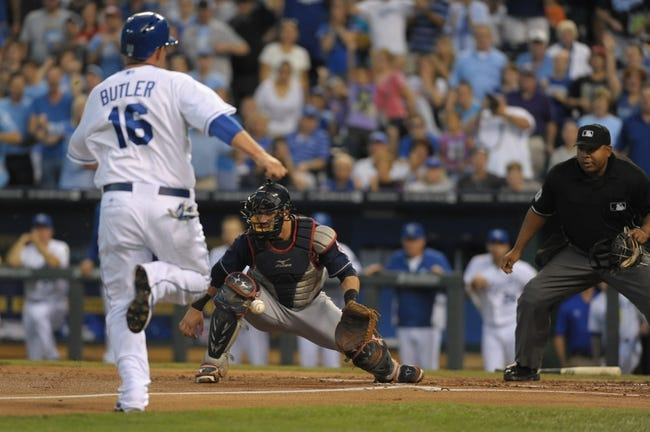 Sep 18, 2013; Kansas City, MO, USA; Cleveland Indians catcher Yan Gomes (10) can't make the play at home as Kansas City Royals designated hitter Billy Butler (16) scores in the first inning at Kauffman Stadium. Mandatory Credit: Denny Medley-USA TODAY Sports