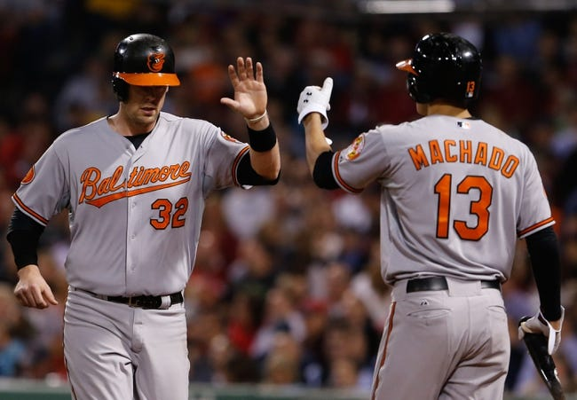Sep 18, 2013; Boston, MA, USA; Baltimore Orioles catcher Matt Wieters (32) is congratulated by third baseman Manny Machado (13) after scoring against the Boston Red Sox in the fifth inning at Fenway Park. Mandatory Credit: David Butler II-USA TODAY Sports