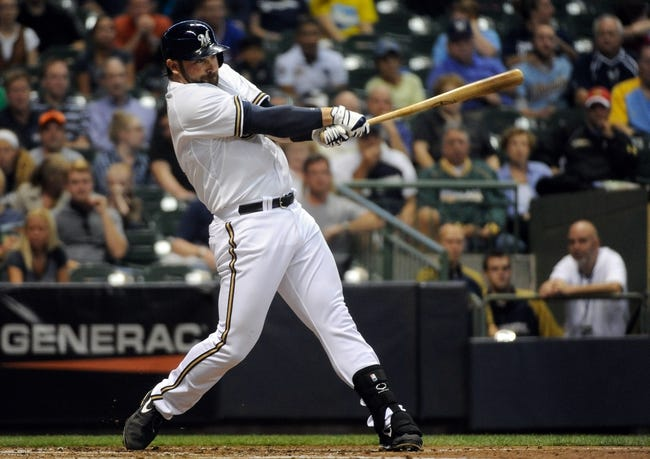 Sep 18, 2013; Milwaukee, WI, USA;  Milwaukee Brewers first baseman Sean Halton hits a grand slam home run in the first inning against the Chicago Cubs at Miller Park. Mandatory Credit: Benny Sieu-USA TODAY Sports