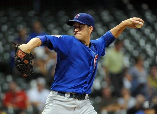 Sep 18, 2013; Milwaukee, WI, USA;   Chicago Cubs pitcher Chris Rusin pitches in the first inning against the Milwaukee Brewers at Miller Park. Mandatory Credit: Benny Sieu-USA TODAY Sports