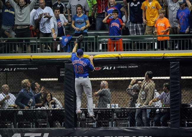 Sep 18, 2013; Milwaukee, WI, USA;  Chicago Cubs right fielder Nate Schierholtz cannot get ball hit by Milwaukee Brewers first baseman Sean Halton (not pictured) for a grand slam home run in the first inning at Miller Park. Mandatory Credit: Benny Sieu-USA TODAY Sports