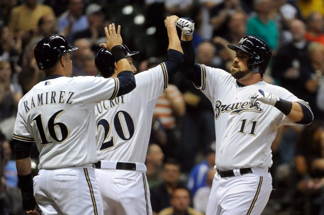 Sep 18, 2013; Milwaukee, WI, USA;   Milwaukee Brewers first baseman Sean Halton (11) is greeted by third baseman Aramis Ramirez (16) and catcher Jonathan Lucroy (20) after hitting a grand slam home run in the first inning at Miller Park. Mandatory Credit: Benny Sieu-USA TODAY Sports