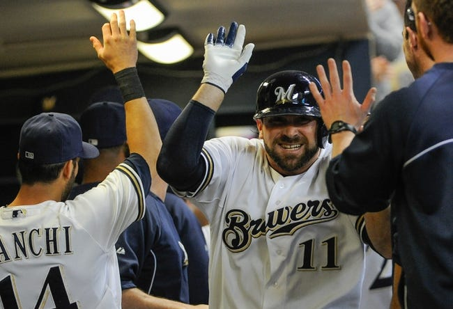 Sep 18, 2013; Milwaukee, WI, USA;   Milwaukee Brewers first baseman Sean Halton (11) is greeted in the dugout after hitting a grand slam home run in the first inning against the Chicago Cubs at Miller Park. Mandatory Credit: Benny Sieu-USA TODAY Sports