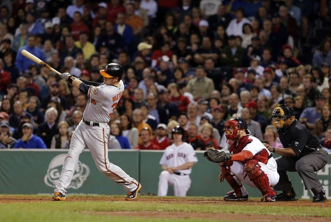 Sep 18, 2013; Boston, MA, USA; Baltimore Orioles catcher Matt Wieters (32) hits a double driving in the go ahead run against the Boston Red Sox in the sixth inning at Fenway Park. Mandatory Credit: David Butler II-USA TODAY Sports