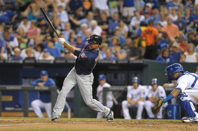 Sep 18, 2013; Kansas City, MO, USA; Cleveland Indians left fielder Michael Brantley (23) connects for a one run double in the third inning of the game against the Kansas City Royals  at Kauffman Stadium. Mandatory Credit: Denny Medley-USA TODAY Sports
