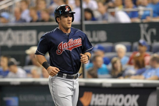 Sep 18, 2013; Kansas City, MO, USA; Cleveland Indians catcher Yan Gomes (10) runs to the dugout after scoring in the third inning of the game against the Kansas City Royals at Kauffman Stadium. Mandatory Credit: Denny Medley-USA TODAY Sports
