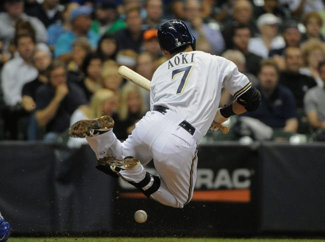 Sep 18, 2013; Milwaukee, WI, USA;   Milwaukee Brewers right fielder Norichika Aoki is hit by a pitch from Chicago Cubs pitcher Alberto Cabrera (not pictured) in the fifth inning at Miller Park. Mandatory Credit: Benny Sieu-USA TODAY Sports