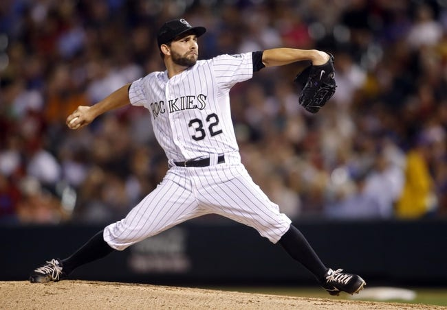 Sep 18, 2013; Denver, CO, USA; Colorado Rockies pitcher Tyler Chatwood (32) delivers a pitch during the third inning against the St. Louis Cardinals at Coors Field. Mandatory Credit: Chris Humphreys-USA TODAY Sports