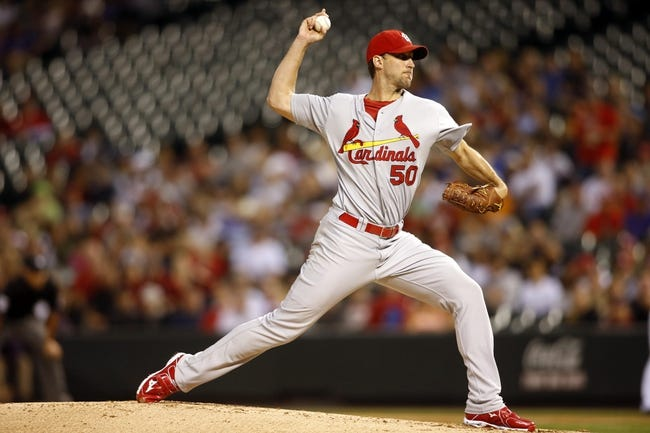 Sep 18, 2013; Denver, CO, USA; St. Louis Cardinals pitcher Adam Wainwright (50) delivers a pitch during the second inning against the Colorado Rockies at Coors Field.  Mandatory Credit: Chris Humphreys-USA TODAY Sports