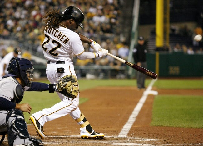 Sep 18, 2013; Pittsburgh, PA, USA; Pittsburgh Pirates center fielder Andrew McCutchen (22) hits a two run home run against the San Diego Padres during the seventh inning at PNC Park. The San Diego Padres won 3-2. Mandatory Credit: Charles LeClaire-USA TODAY Sports