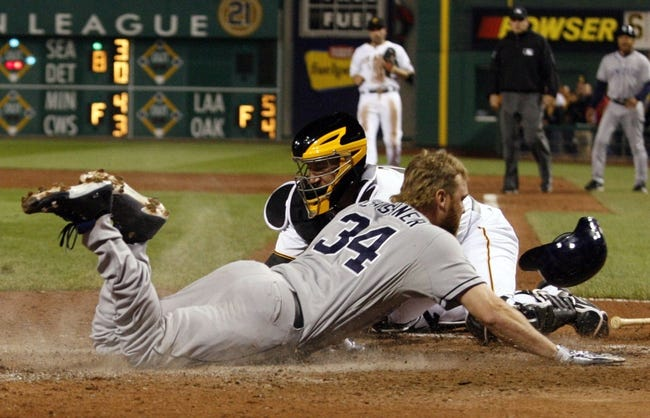 Sep 18, 2013; Pittsburgh, PA, USA; San Diego Padres pinch runner Andrew Cashner (34) scores the game tying run ahead of a tag attempt by Pittsburgh Pirates catcher John Buck (back) during the ninth inning at PNC Park. The San Diego Padres won 3-2. Mandatory Credit: Charles LeClaire-USA TODAY Sports
