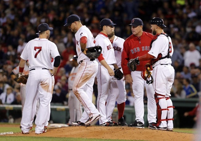 Sep 18, 2013; Boston, MA, USA; Boston Red Sox manager John Farrell (53) brings in relief pitcher Junichi Tazawa (36) against the Baltimore Orioles in the eighth inning at Fenway Park. Mandatory Credit: David Butler II-USA TODAY Sports