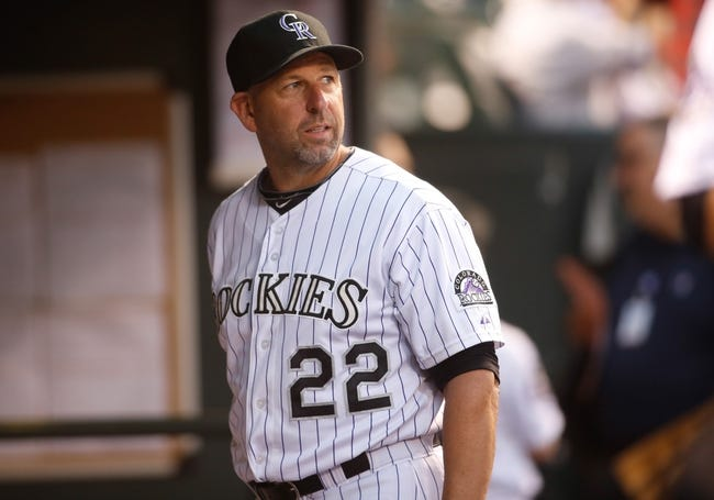 Sep 18, 2013; Denver, CO, USA; Colorado Rockies manager Walt Weiss (22) in the dugout before the first inning against the St. Louis Cardinals at Coors Field. Mandatory Credit: Chris Humphreys-USA TODAY Sports