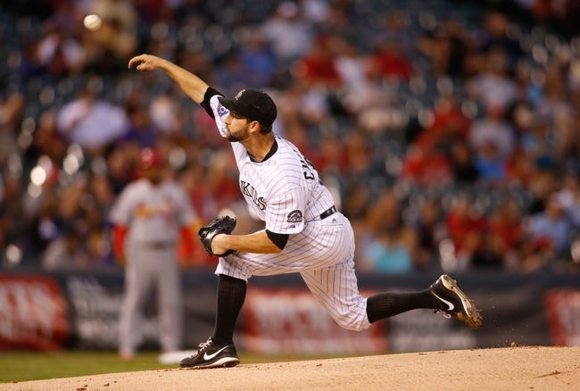 Sep 18, 2013; Denver, CO, USA; Colorado Rockies pitcher Tyler Chatwood (32) delivers a pitch during the first inning against the St. Louis Cardinals at Coors Field. Mandatory Credit: Chris Humphreys-USA TODAY Sports