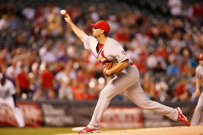 Sep 18, 2013; Denver, CO, USA; St. Louis Cardinals pitcher Adam Wainwright (50) delivers a pitch during the first inning against the Colorado Rockies at Coors Field. Mandatory Credit: Chris Humphreys-USA TODAY Sports