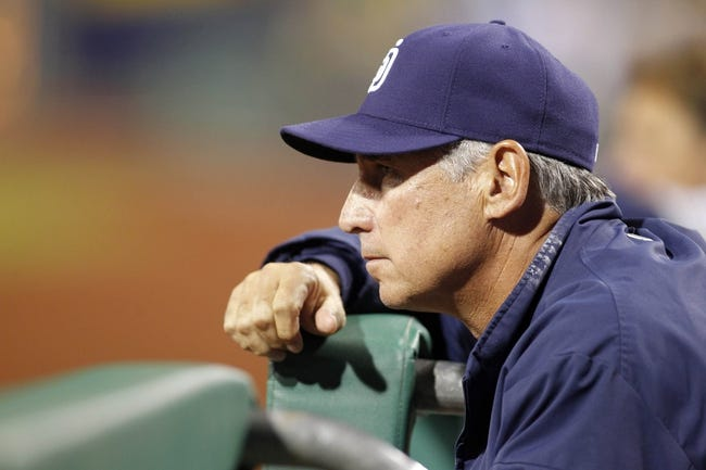 Sep 18, 2013; Pittsburgh, PA, USA; San Diego Padres manager Bud Black (20) watches the action from the top step of the dugout against the Pittsburgh Pirates during the seventh inning at PNC Park. The San Diego Padres won 3-2. Mandatory Credit: Charles LeClaire-USA TODAY Sports
