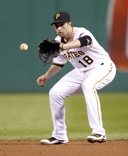 Sep 18, 2013; Pittsburgh, PA, USA; Pittsburgh Pirates second baseman Neil Walker (18) fields a ground ball against the San Diego Padres during the eighth inning at PNC Park. The San Diego Padres won 3-2. Mandatory Credit: Charles LeClaire-USA TODAY Sports