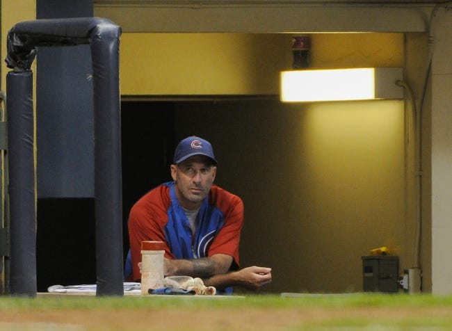 Sep 18, 2013; Milwaukee, WI, USA;   Chicago Cubs manager Dale Sveum watches the game against the Milwaukee Brewers from the dugout in the seventh inning at Miller Park. Mandatory Credit: Benny Sieu-USA TODAY Sports