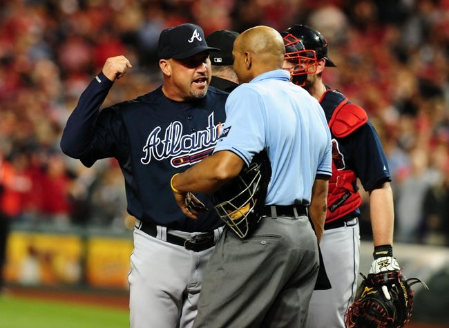 Sep 18, 2013; Washington, DC, USA; Atlanta Braves manager Fredi Gonzalez (left) argues with home plate umpire CB Buckner (right) during the game against the Washington Nationals at Nationals Park. Mandatory Credit: Evan Habeeb-USA TODAY Sports