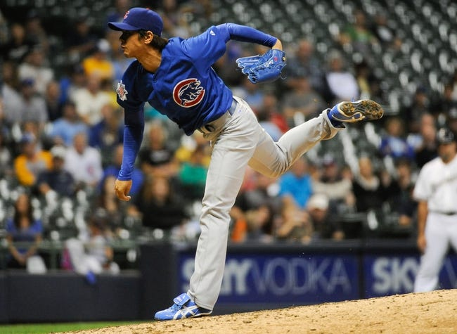 Sep 18, 2013; Milwaukee, WI, USA;   Chicago Cubs pitcher Chang-Yong Lim pitches in the seventh inning against the Milwaukee Brewers at Miller Park. Mandatory Credit: Benny Sieu-USA TODAY Sports
