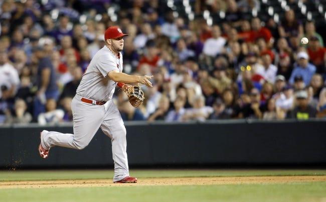 Sep 18, 2013; Denver, CO, USA; St. Louis Cardinals first baseman Matt Adams (53) fields a ground ball during the fifth inning against the Colorado Rockies at Coors Field.  Mandatory Credit: Chris Humphreys-USA TODAY Sports
