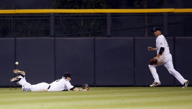 Sep 18, 2013; Denver, CO, USA; Colorado Rockies center fielder Charlie Blackmon (19) fails to catch a fly ball as right fielder Michael Cuddyer (right) chases down the ball during the fifth inning against the St. Louis Cardinals at Coors Field. Mandatory Credit: Chris Humphreys-USA TODAY Sports
