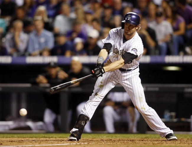 Sep 18, 2013; Denver, CO, USA; Colorado Rockies center fielder Charlie Blackmon (19) hits an RBI double during the sixth inning against the St. Louis Cardinals at Coors Field. Mandatory Credit: Chris Humphreys-USA TODAY Sports