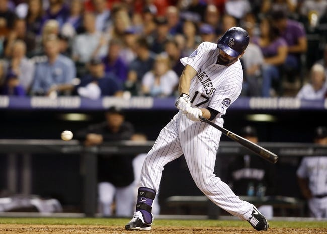 Sep 18, 2013; Denver, CO, USA; Colorado Rockies first baseman Todd Helton (17) hits a double during the sixth inning against the St. Louis Cardinals at Coors Field. Mandatory Credit: Chris Humphreys-USA TODAY Sports