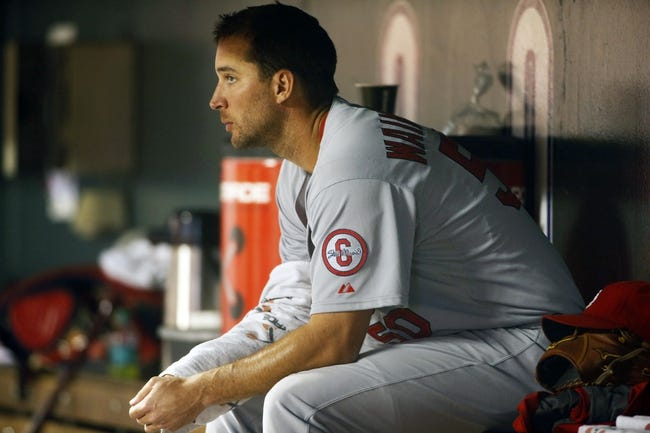 Sep 18, 2013; Denver, CO, USA; St. Louis Cardinals pitcher Adam Wainwright (50) watches from the dugout during the fifth inning against the Colorado Rockies at Coors Field.  Mandatory Credit: Chris Humphreys-USA TODAY Sports