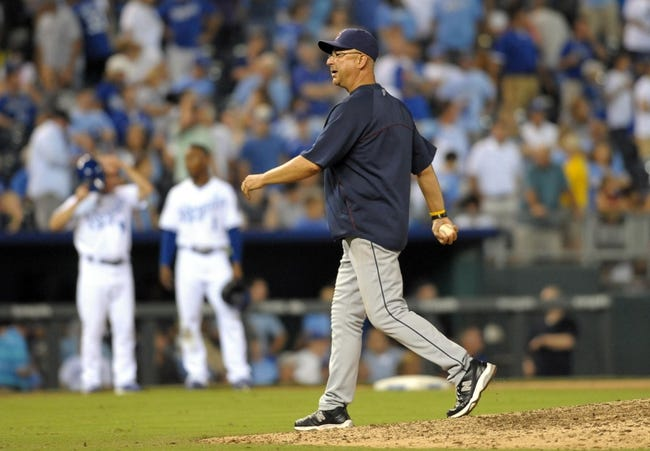 Sep 18, 2013; Kansas City, MO, USA; Cleveland Indians manager Terry Francona (17) returns to the dugout from a visit to the mound in the eighth inning of the game against the Kansas City Royals at Kauffman Stadium. The Royals won 7-2. Mandatory Credit: Denny Medley-USA TODAY Sports