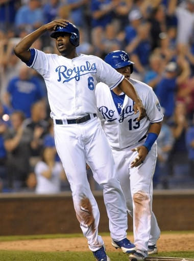 Sep 18, 2013; Kansas City, MO, USA; Kansas City Royals center fielder Lorenzo Cain (6) celebrates after scoring in the eighth inning of the game against the Cleveland Indians at Kauffman Stadium. The Royals won 7-2. Mandatory Credit: Denny Medley-USA TODAY Sports
