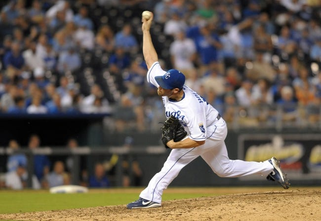 Sep 18, 2013; Kansas City, MO, USA; Kansas City Royals relief pitcher Greg Holland (56) delivers a pitch in the ninth inning of the game against the Cleveland Indians at Kauffman Stadium. The Royals won 7-2. Mandatory Credit: Denny Medley-USA TODAY Sports