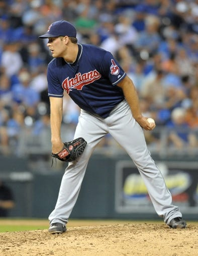 Sep 18, 2013; Kansas City, MO, USA; Cleveland Indians relief pitcher Nick Hagadone (50) delivers a pitch in the eighth inning of the game against the Kansas City Royals at Kauffman Stadium. The Royals won 7-2. Mandatory Credit: Denny Medley-USA TODAY Sports
