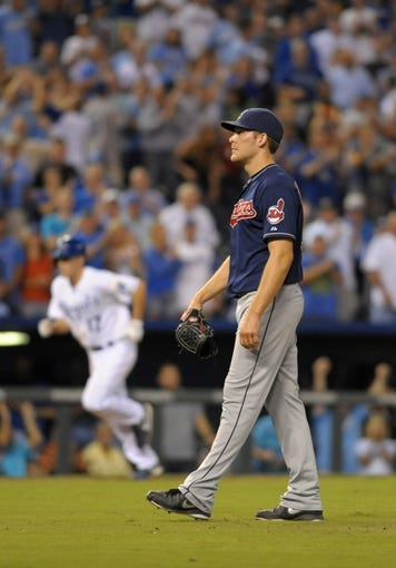 Sep 18, 2013; Kansas City, MO, USA; Cleveland Indians relief pitcher Nick Hagadone (50) reacts after walking in a run in the eighth inning of the game against the Kansas City Royals at Kauffman Stadium. The Royals won 7-2. Mandatory Credit: Denny Medley-USA TODAY Sports