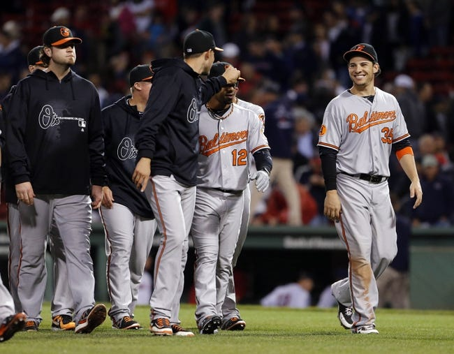 Sep 18, 2013; Boston, MA, USA; Baltimore Orioles designated hitter Danny Valencia (right) and his teammates react after defeating the Boston Red Sox 5-3 at Fenway Park. Mandatory Credit: David Butler II-USA TODAY Sports