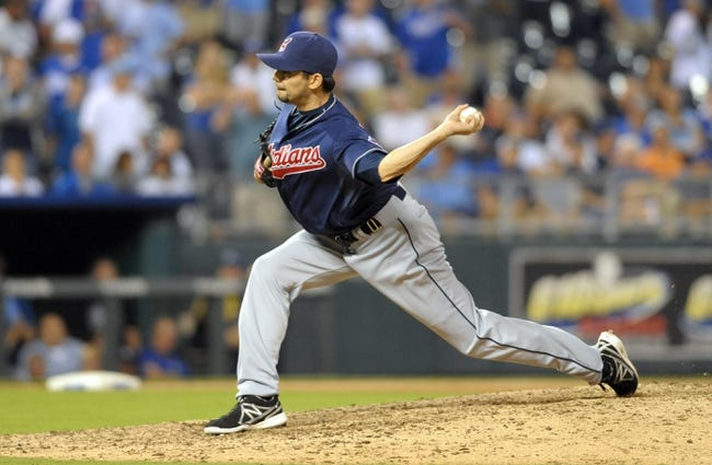 Sep 18, 2013; Kansas City, MO, USA; Cleveland Indians relief pitcher Clay Rapada (57) delivers a pitch in the eighth inning of the game against the Kansas City Royals at Kauffman Stadium. The Royals won 7-2. Mandatory Credit: Denny Medley-USA TODAY Sports