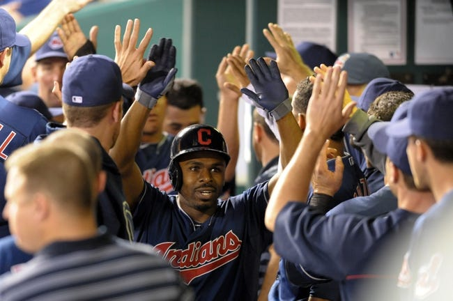 Sep 18, 2013; Kansas City, MO, USA; Cleveland Indians outfielder Michael Bourn (23) is congratulated in the dugout after scoring in the third inning of the game against the Kansas City Royals at Kauffman Stadium. Mandatory Credit: Denny Medley-USA TODAY Sports