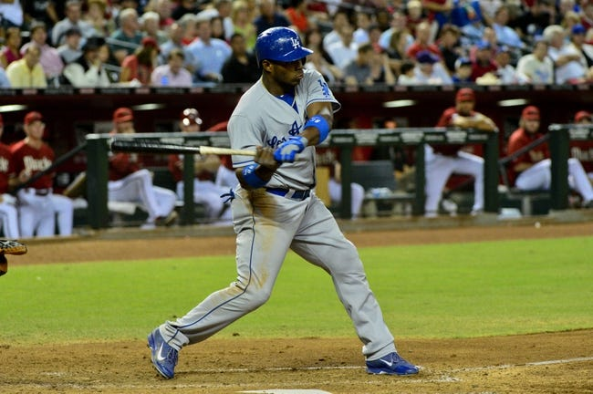 Sep 18, 2013; Phoenix, AZ, USA; Los Angeles Dodgers right fielder Yasiel Puig (66) hits a solo home run during fourth inning against the Arizona Diamondbacks at Chase Field. Mandatory Credit: Matt Kartozian-USA TODAY Sports