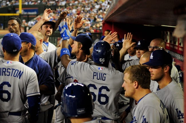 Sep 18, 2013; Phoenix, AZ, USA; Los Angeles Dodgers right fielder Yasiel Puig (66) celebrates with teammates after hitting a solo home run during the fourth inning against the Arizona Diamondbacks at Chase Field. Mandatory Credit: Matt Kartozian-USA TODAY Sports