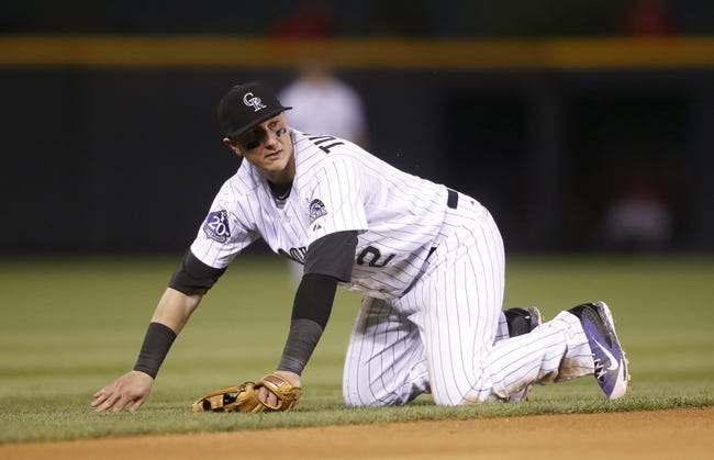 Sep 18, 2013; Denver, CO, USA; Colorado Rockies shortstop Troy Tulowitzki (2) during the seventh inning against the St. Louis Cardinals at Coors Field. Mandatory Credit: Chris Humphreys-USA TODAY Sports