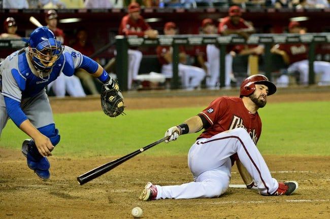 Sep 18, 2013; Phoenix, AZ, USA; Los Angeles Dodgers catcher Tim Federowicz (18) fields a ball hit by Arizona Diamondbacks left fielder Adam Eaton (6) during the fifth inning at Chase Field. Mandatory Credit: Matt Kartozian-USA TODAY Sports