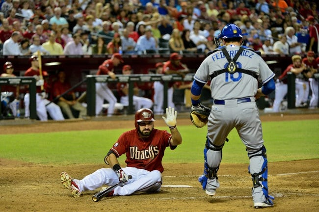 Sep 18, 2013; Phoenix, AZ, USA; Los Angeles Dodgers catcher Tim Federowicz (18) tags Arizona Diamondbacks left fielder Adam Eaton (6) out during the fifth inning at Chase Field. Mandatory Credit: Matt Kartozian-USA TODAY Sports