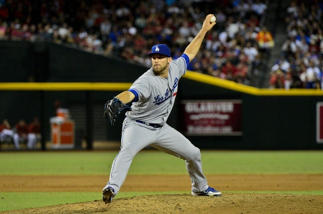 Sep 18, 2013; Phoenix, AZ, USA; Los Angeles Dodgers relief pitcher Paco Rodriguez (75) throws during the sixth inning against the Arizona Diamondbacks at Chase Field. Mandatory Credit: Matt Kartozian-USA TODAY Sports