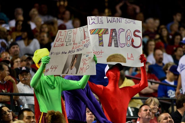 Sep 18, 2013; Phoenix, AZ, USA; Arizona Diamondbacks fans hold signs during the sixth inning against the Los Angeles Dodgers at Chase Field. Mandatory Credit: Matt Kartozian-USA TODAY Sports
