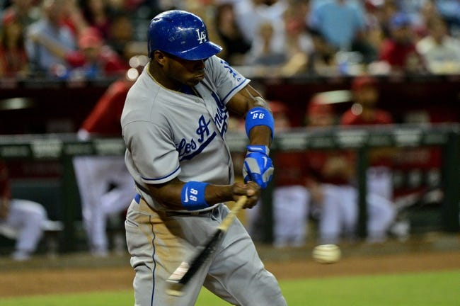 Sep 18, 2013; Phoenix, AZ, USA; Los Angeles Dodgers right fielder Yasiel Puig (66) hits a single during the seventh inning against the Arizona Diamondbacks at Chase Field. Mandatory Credit: Matt Kartozian-USA TODAY Sports