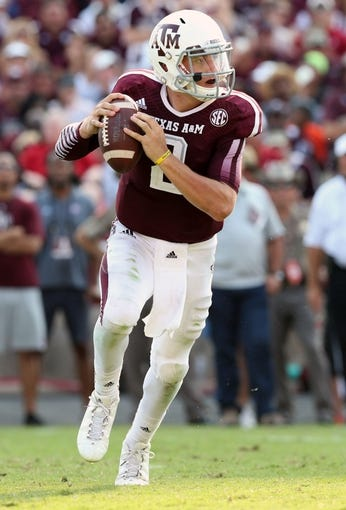 Sep 14, 2013; College Station, TX, USA; Texas A&M Aggies  quarterback Johnny Manziel (2) rolls out of the pocket against the Alabama Crimson Tide at Kyle Field. Mandatory Credit: Matthew Emmons-USA TODAY Sports