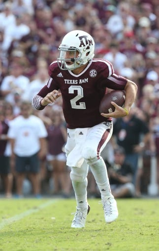 Sep 14, 2013; College Station, TX, USA; Texas A&M Aggies  quarterback Johnny Manziel (2) scrambles in the fourth quarter against the Alabama Crimson Tide at Kyle Field. Alabama Crimson Tide beat the Texas A&M Aggies 49-42. Mandatory Credit: Matthew Emmons-USA TODAY Sports