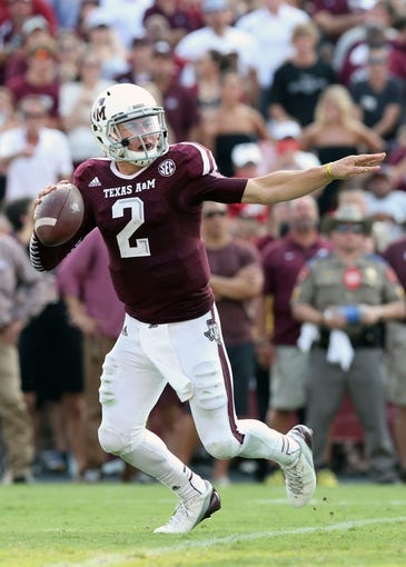 Sep 14, 2013; College Station, TX, USA; Texas A&M Aggies  quarterback Johnny Manziel (2) directs his team as he scrambles against the Alabama Crimson Tide at Kyle Field. Mandatory Credit: Matthew Emmons-USA TODAY Sports